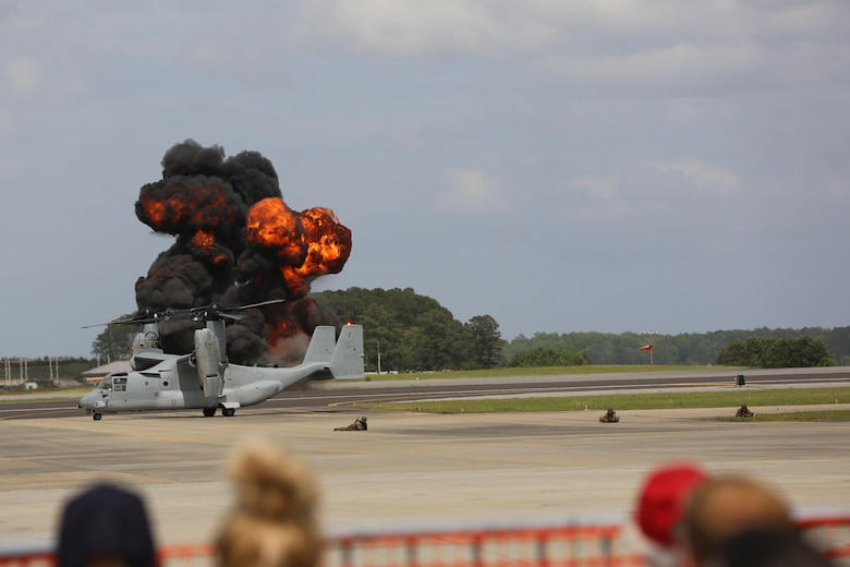"The Marine Air-Ground Task Force performs high speed demonstration on the flight line at the 2016 Marine Corps Air Station Cherry Point Air Show – ""Celebrating 75 Years"" at MCAS Cherry Point, N.C., May 1, 2016. The Marine Air-Ground Task Force is designed for swift deployment of Marine forces by air, land or sea. This year's air show celebrated MCAS Cherry Point and 2nd Marine Aircraft Wing's 75th anniversaries and featured 40 static displays, 17 aerial performers and a concert. (U.S. Marine Corps photo by Lance Cpl. Mackenzie Gibson/ Released)"