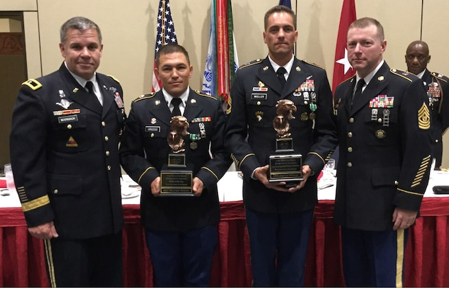 Spc. Michael S. Orozco, second from left, representing the 416th Theater Engineer Command, and Sgt. 1st Class Joshua Moeller, representing the 108th Training Command (Initial Entry Training), were named the Soldier and Noncommissioned Officer of the Year during an awards ceremony at the U.S. Army Reserve Best Warrior Competition, May 6, at the Iron Mike Conference Center, Fort Bragg, N.C. Orozco and Moeller will represent the U.S. Army Reserve at the Army Best Warrior Competition later this year at Fort A.P. Hill, Va. Pictured with Orozco and Moeller are Brig. Gen. Michael J. Warmack, left, U.S. Army Reserve Command G-3/5/7, and Command Sgt. Maj. James P. Wills, interim command sergeant major of the U.S. Army Reserve. (U.S. Army photo by Timothy L. Hale) (Released)