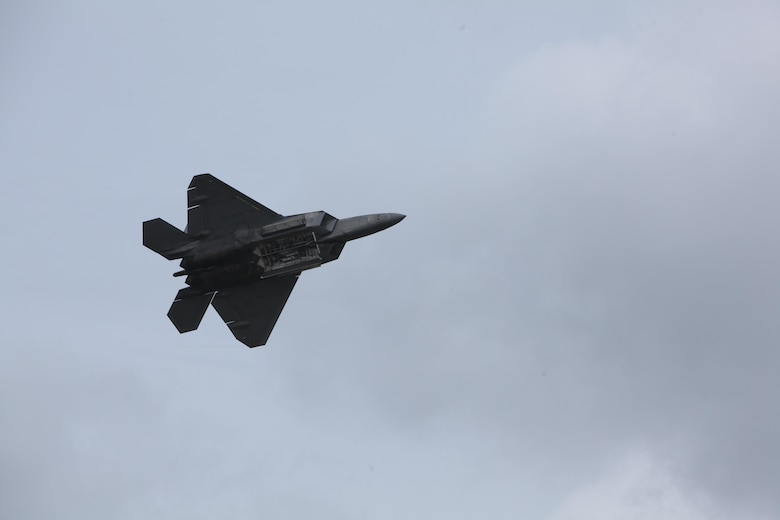 "An F-22 Raptor soars through the sky and amazes airshow patrons at the 2016 Marine Corps Air Station Cherry Point Air Show – ""Celebrating 75 Years"" at MCAS Cherry Point, N.C., May 1, 2016. The Air Force's F-22 Raptor combines sensor capabilities with integrated avionics, situational awareness and weapons to provide the first-kill opportunity against threats by performing air-to-air and air-to-ground missions. This year's air show celebrated MCAS Cherry Point and 2nd Marine Aircraft Wing's 75th anniversary and featured 40 static displays, 17 aerial performers, as well as a concert."