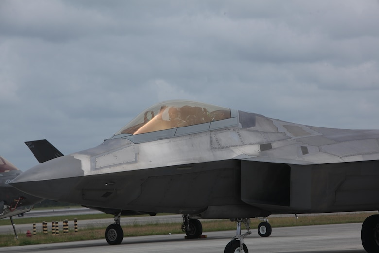 "An F-22 Raptor sits on the flight line at the 2016 Marine Corps Air Station Cherry Point Air Show – ""Celebrating 75 Years"" at MCAS Cherry Point, N.C., May 1, 2016. The Air Force's F-22 Raptor combines sensor capabilities with integrated avionics, situational awareness and weapons to provide the first-kill opportunity against threats by performing air-to-air and air-to-ground missions. This year's air show celebrated MCAS Cherry Point and 2nd Marine Aircraft Wing's 75th anniversary and featured 40 static displays, 17 aerial performers, as well as a concert."