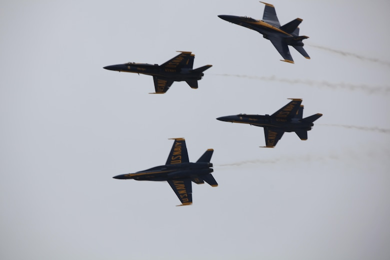 "The U.S. Navy Blue Angels fly through the sky during the 2016 Marine Corps Air Station Cherry Point Air Show -- ""Celebrating 75 Years"" at MCAS Cherry Point , N.C., April 30, 2016. Blue Angels showcase the pride and professionalism of the Navy and the Marine Corps by inspiring a culture of excellence and service to country through flight demonstrations and community outreach. This year's air show celebrated MCAS Cherry Point and 2nd Marine Aircraft Wing's 75th anniversary and featured 40 static displays, 17 aerial performers, as well as a concert."