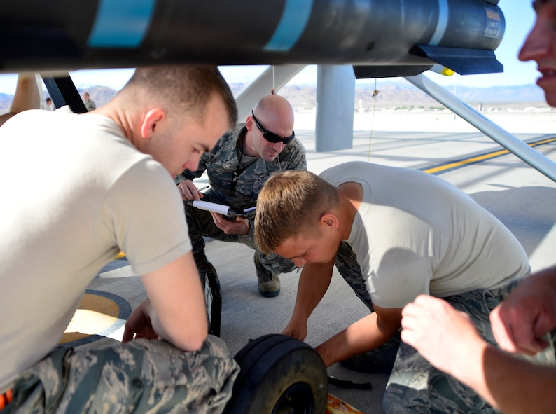 Tech. Sgt. Bryan, 432nd Maintenance Group technical order distribution office specialist, watches as a 432nd Aircraft Maintenance Squadron Tiger Aircraft Maintenance Unit team completes a brake adjustment on an MQ-1 Predator May 3, 2016. Bryan is a member of the 432nd MXG quality assurance shop which ensures the quality of maintenance performed on the MQ-1 Predator and MQ-9 Reaper. (U.S. Air Force photo by Senior Airman Christian Clausen/Released)