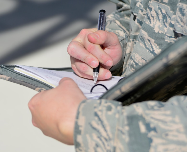 Tech. Sgt. Remington, 432nd Maintenance Group quality assurance inspector, takes notes as a 432nd Aircraft Maintenance Squadron Tiger Aircraft Maintenance Unit team checks the weight and balance of an MQ-1 Predator May 3, 2016. QA personnel are accountable for being knowledgeable and well-trained, enforcing the standards, and inspecting all the work performed on the MQ-1 Predator and MQ-9 Reaper within the 432nd Maintenance Group. (U.S. Air Force photo by Senior Airman Christian Clausen/Released)