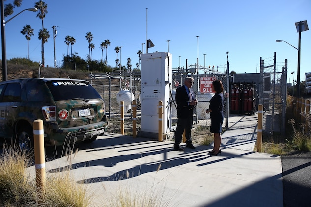 Ms. Christine Harada, Chief of Federal Sustainability Officer, right, receives a brief from Mr. Gary Funk, left, on the Hydrogen Refueling Station aboard Camp Pendleton, Calif., Dec. 29, 2015. The purpose of the visit was to provide the new White House Federal Chief Sustainability Officer information and background regarding Marine Corps Installations West-Marine Corps Base Camp Pendleton's electric vehicle procurement, renewable energy, and how water sustainability programs support the Untied States Marine Corps mission and readiness. (U.S. Marine Corps Photo by Gunnery Sgt. Evan P. Ahlin/Released)