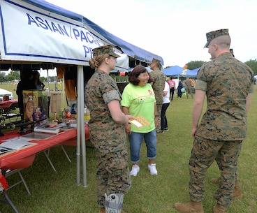 Marines visit the Asian/Pacific tent during the annual Unity Day celebration recently on the installation. The event is held to educate individuals on diversity and celebrate differences.