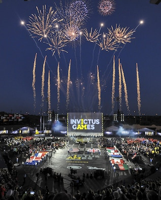 Fireworks erupt as the flags of 15 nations are displayed during the opening ceremony for Invictus Games 2016 at the ESPN Wide World of Sports Complex in Orlando, Fla., May 8, 2016. The 2016 Invictus Games officially kicked off with the ceremony and wounded warriors will compete over the next five days in multiple adaptive sports events. (U.S. Air Force photo/Senior Master Sgt. Kevin Wallace)