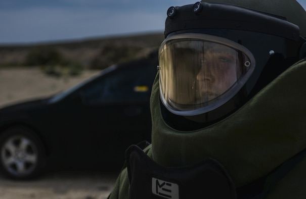 Staff Sgt. John Mitchell, 99th Civil Engineer Squadron explosive ordinance technician, wears an EOD suit during a training exercise at Nellis Air Force Base, Nev., May 5, 2016. Trained to detect, disarm, detonate and dispose of explosive threats all over the world, EODs are the specialists who bravely serve as the Air Force's bomb squad. (U.S. Air Force photo by Airman 1st Class Kevin Tanenbaum)