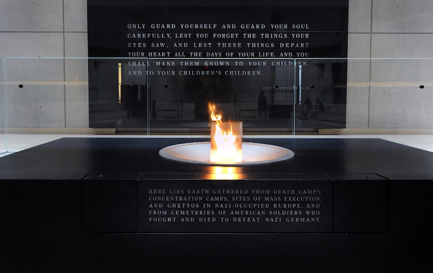 An eternal flame burns inside the Hall of Remembrance at the United States Holocaust Memorial located in Washington D.C. The memorial reminds visitors to never forget the Holocaust and how events like this can be prevented if you remember the past. (Department of Defense photo by Marvin Lynchard)