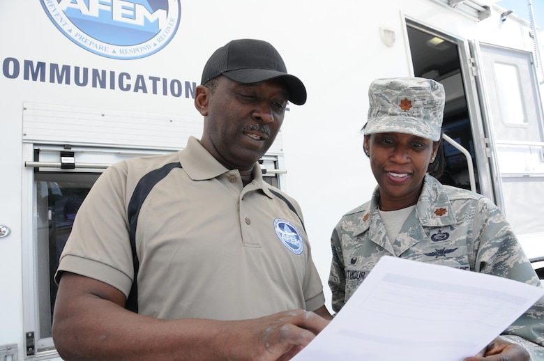 Senior Master Sgt. Kelvin Battle, 94th Emergency Management specialist, and Maj. Andrea Walthour, 94th Communications Squadron commander, review information during the 2016 Statewide Mobile Communication Vehicle Functional Field Exercise, held at Stone Mountain, Ga., May 3-6. The exercise was designed to test on-the-scene communication capability between the federal, state, and local emergency response organizations that participated. (U.S. Air Force photo/ Staff Sgt. Alan Abernethy)