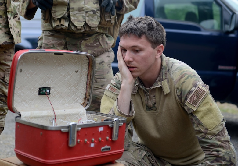 Staff Sgt. David Dezwaan, 60th Civil Engineer Squadron explosive ordnance disposal technician, inspects the wiring of a simulated radioactive dispersal device during an exercise May 5th, 2016, at Clear Lake, California. Dezwaan and other EOD technicians were able to eliminate the threat of numerous improvised explosive devices and the radioactive dispersal device during Operation: Half-Life, an exercise designed to evaluate a synchronized, multi-agency response to a crisis situation. (U.S. Air Force photo by Senior Airman Bobby Cummings)