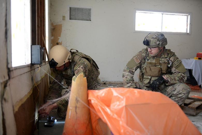 Staff Sgt. David Dezwaan (left), and Airman 1st Class Alex Nona, 60th Civil Engineer Squadron explosive ordnance disposal technicians, diffuse a simulated improvised explosive device May 5th, 2016, at Clear Lake, California. Dezwaan and Nona were participating in Operation: Half-Life, an exercise designed to evaluate a synchronized, multi-agency response to a crisis situation. (U.S. Air Force photo by Senior Airman Bobby Cummings)