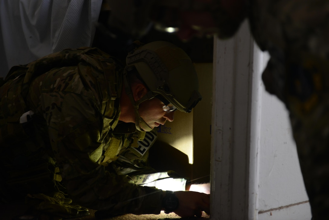 Tech. Sgt. Noah Cheney, 9th Civil Engineer Squadron explosive ordnance disposal technician, diffuses a simulated improvised explosive device May 5th, 2016, at Clear Lake, California. Cheney was participating in Operation: Half-Life, an exercise designed to evaluate a synchronized, multi-agency response to a crisis situation. (U.S. Air Force photo by Senior Airman Bobby Cummings)