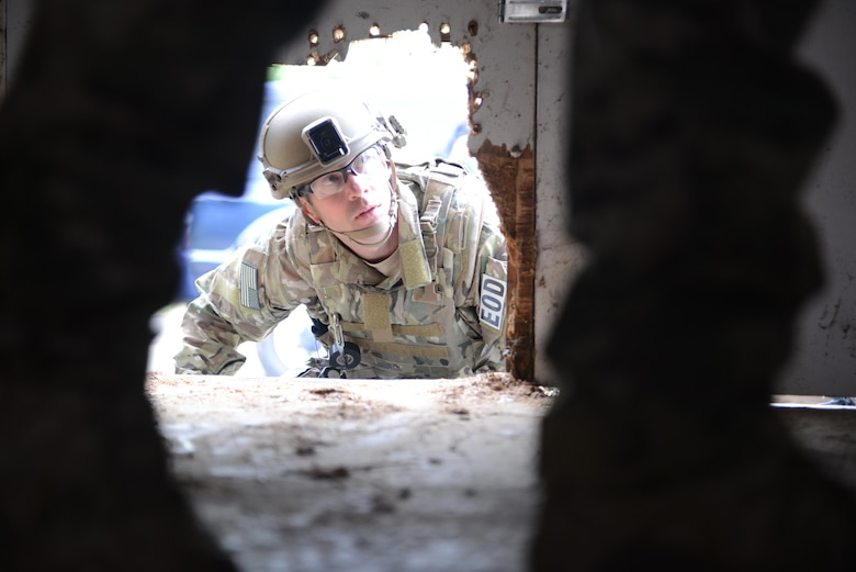 "Tech. Sgt. Noah Cheney, 9th Civil Engineer Squadron explosive ordnance disposal technician, prepares to enter an abandoned structure known as the ""bomb factory"" during an exercise May 5th, 2016, at Clear Lake, California. Cheney and other EOD technicians were tasked to eliminate numerous improvised explosive devices and a radioactive dispersal device within the abandoned structure. (U.S. Air Force photo by Senior Airman Bobby Cummings)"