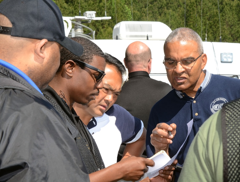 Mobile Communication Vehicle Exercise Team 3 members, John Jones, from the Atlanta Police Department Emergency Management Unit, Tech. Sgt. Stephen Athey, from the 94th Communications Squadron, and Conrad Pedersen from the 94th Mission Support Group, Emergency Management Unit, review exercise input during the 2016 Statewide Mobile Communication Vehicle (MCV) Functional Field Exercise (FFX) held at Stone Mountain State Park, Stone Mountain, Ga. May 2-6, 2016. The exercise presents a series of catastrophe type scenarios testing critical communication and coordination between MCV emergency response agencies from around the State of Georgia. (U.S. Air Force photo/Don Peek)