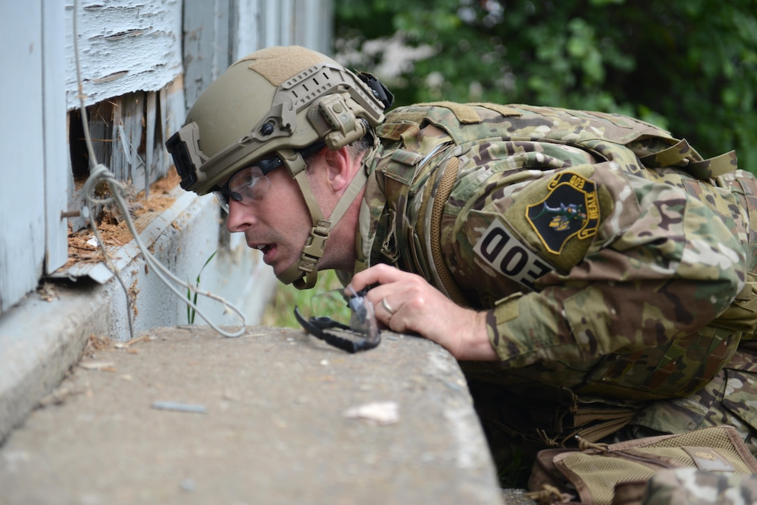 """Tech. Sgt. Noah Cheney, 9th Civil Engineer Squadron explosive ordnance disposal technician, evaluates potential entry access points to an abandoned structure known as the """"bomb factory"""" during Operation: Half-Life, an exercise designed to evaluate a synchronized, multi-agency response to a crisis situation May 5th, 2016, at Clear Lake, California. The structure Cheney needed access to contained various improvised explosive devices. (U.S. Air Force photo by Senior Airman Bobby Cummings)"""