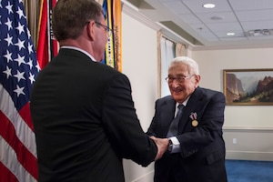 Defense Secretary Ash Carter shakes hands with former Secretary of State Henry A. Kissinger after presenting Kissinger with the Department of Defense Distinguished Public Service Award at the Pentagon, May 9, 2016. DoD photo by Air Force Senior Master Sgt. Adrian Cadiz