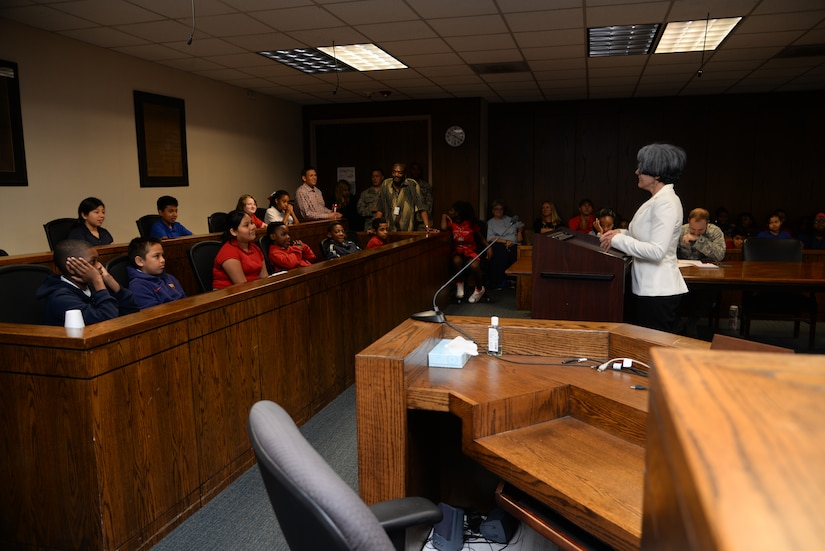 After deliberating, jury members from Lambs Elementary school unanimously agree that Cruella Deville is guilty during the mock court martial May 3, 2016, at Joint Base Charleston, S.C. Fifth grade students from Lambs Elementary acted as jurors, lawyers and bailiff during the mock trial. This was the second year that the JB Charleston legal team opened their courtroom doors for students to learn the military legal process in celebration of Law Day.