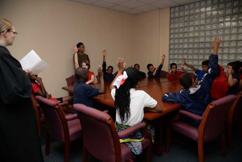 Ms. Erin Dixon acts as Cruella Deville pleading her case before jury members during a mock court-martial, U.S. versus Cruella Deville. The jurors deliberated before sentencing Deville May 3, 2016, at Joint Base Charleston, S.C. Students from Lambs Elementary acted as jurors, lawyers and bailiff during the mock trial. This was the second year that the JB Charleston legal team opened their courtroom doors for students to learn the military legal process in celebration of Law Day.