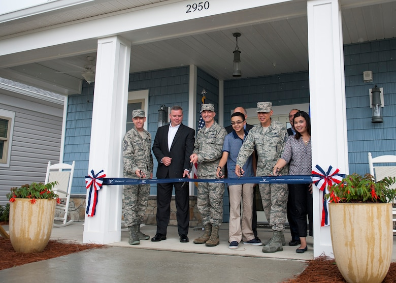 Brig. Gen. Christopher Azzano, 96th Test Wing commander, and Chief Master Sgt. Bryan Creager, 96th TW  command chief, join Corvias Military Living personnel to cut the ribbon at the grand opening of the first 747 new homes and Warrior Landing Community Center May 3 at Eglin Air Force Base, Fla. The 12,000 square foot facility features a club room, fitness center, children's play area, gym, yoga studio and an outdoor entertainment area with a pool. (U.S. Air Force photo/Ilka Cole)