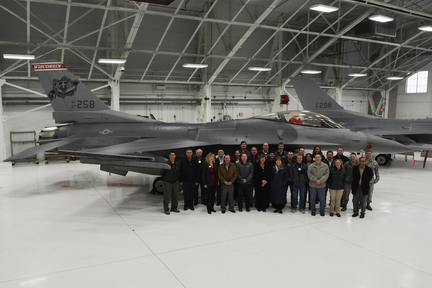 Members of the American Society of Safety Engineers region V posed in front of a 115th Fighter Wing F-16 Fighting Falcon in Hangar 406 at Truax Field, Madison, Wis., April 7, 2016. The 115 FW hosted the ASSE's annual operating committee meeting on base. Each year the meeting is held at a different location, giving members an opportunity to tour various companies and facilities. (U.S. Air National Guard photo by Staff Sgt. Andrea F. Rhode)