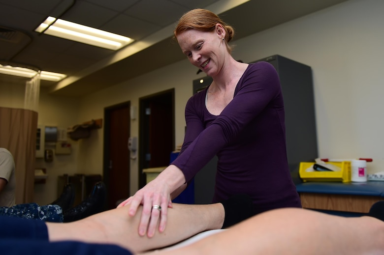 Megan Murphy, 460th Medical Group physical therapist, works with a patient May 5, 2016, at the Health and Wellness Center on Buckley Air Force Base, Colo. Public Service Recognition Week, organized by Public Employees Roundtable, has been celebrated during the first week of May since 1985 and honors the government civilians working in the military world. (U.S. Air Force photo by Airman 1st Class Gabrielle Spradling/Released)