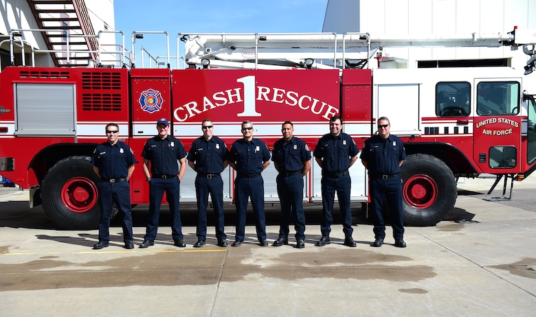 Members of the Buckley Fire Department stand with a fire truck May 5, 2016, on Buckley Air Force Base, Colo. The goal of Public Service Recognition Week is to foster esprit de corps and recognize all of the contributions and knowledge that civilian government employees bring to our nation's defense and their local communities. (U.S. Air Force photo by Airman 1st Class Gabrielle Spradling/Released)
