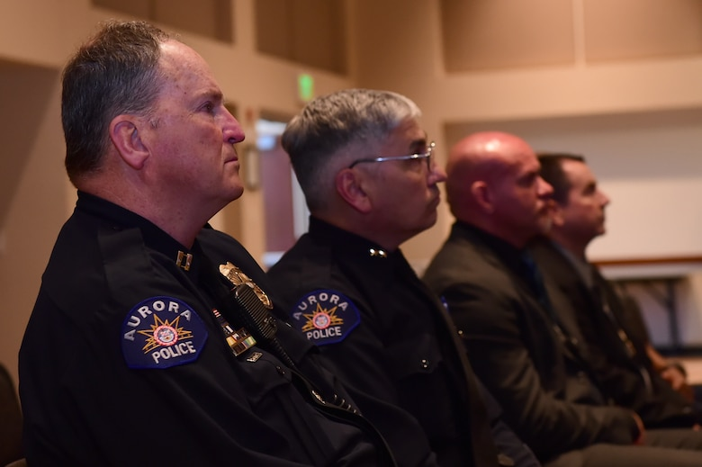 Law enforcement officers from the Aurora Police Department look on during a ceremony commemorating the beginning of National Police Week May 9, 2016, at the Leadership Development Center on Buckley Air Force Base, Colo. National Police Week was first established by Congress in 1962 and honors those who have lost their lives in the line of duty. (U.S. Air Force photo by Airman 1st Class Luke W. Nowakowski/Released)
