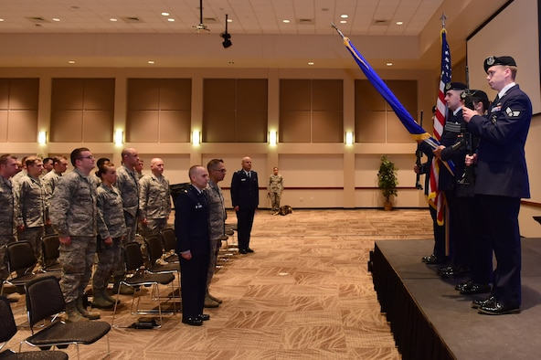 460th Security Forces Squadron Honor Guard presents the colors May 9, 2016, at the Leadership Development Center on Buckley Air Force Base, Colo. Members from Buckley AFB gathered with local law enforcement to commemorate the start of National Police Week, which recognizes officers who have lost their lives in the line of duty. (U.S. Air Force photo by Airman 1st Class Luke W. Nowakowski/Released)
