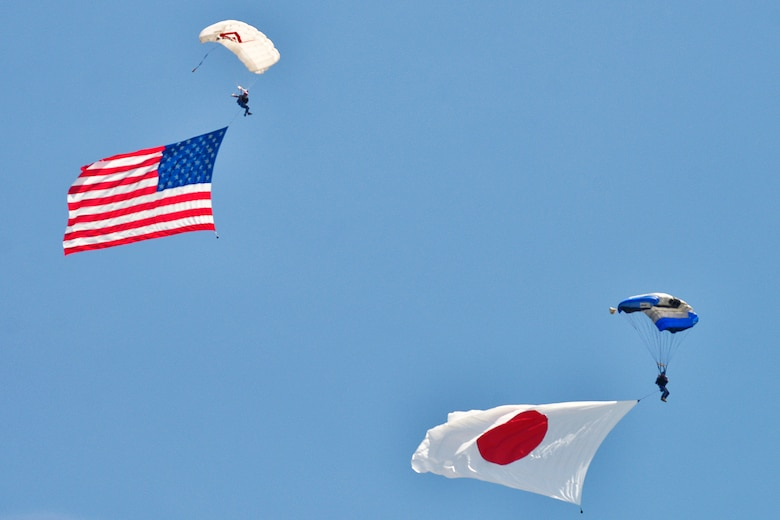 Jumpers glide to the ground with U.S. and Japan flags during the 2016 Friendship Day at Marine Corps Air Station Iwakuni, Japan, May 5, 2016. The event showcased a variety of static displays, aviation performances and demonstrations, and provided food and entertainment for guests of the largest single-day event at Iwakuni each year. (U.S. Air Force photo by Senior Airman David Owsianka/Released)