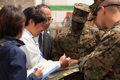 SENDAI, Japan – Capt. Emmanuel Baning, the Officer Conducting Exercise for Artillery Relocation Training Program 16-1, works with Japanese embarkation contractors overseeing the unloading of artillery at Sendai Port on May 9, 2016. Baning is with 3rd Battalion, 12th Marine Regiment, 3rd Marine Division, III Marine Expeditionary Force, based out of Camp Hansen, Okinawa, Japan and is from Washington, D.C.