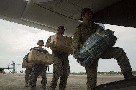 U.S. Marines and Japanese service members load supplies into MV-22B Osprey, assigned to the Marine Medium Tiltrotor Squadron 265 (Reinforced), 31st Marine Expeditionary Unit, in Japan Ground Self Defense Force Takayumaru Camp April 18, 2016. The supplies were in support of the relief effort after a series of earthquakes struck the island of Kyushu. (U.S. Marine Corps photo by Cpl. Samantha Villarreal)