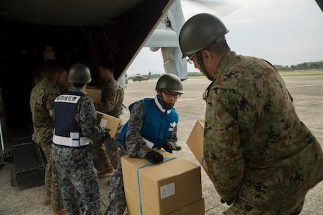 Marines and Japanese service members load supplies into MV-22B Ospreys with Marine Medium Tiltrotor Squadron 265 (Reinforced), 31st Marine Expeditionary Unit in Japan Ground Self Defense Force Takayumaru Camp April 18, 2016. The supplies are in support of the relief effort after a series of earthquakes struck the island of Kyushu. The 31st MEU is the only continually forward-deployed MEU and remains the Marine Corps' force-in-readiness in the Asia-Pacific region.