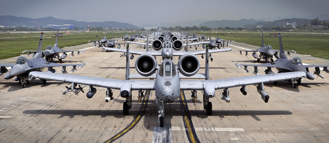 "A-10 Thunderbolt II and F-16 Fighting Falcon fighter aircraft perform an 'Elephant Walk' on the runway this week during Exercise Beverly Herd 16-01 at Osan Air Base, Republic of Korea.  The Elephant Walk was a demonstration of U.S. Air Force capabilities and strength and showcases the wing's ability to generate combat airpower in an expedient manner in order to respond to simulated contingency operations. The A-10 Thunderbolt II aircraft are from the 25th Fighter Squadron ""Draggins"" and the F-16 Fighting Falcon aircraft are from the 36th Fighter Squadron ""Fiends"" of the 51st Fighter Wing, Osan AB, ROK; the additional F-16 aircraft are from the 179th Fighter Squadron ""Bulldogs"" of the 148th Fighter Wing out of Duluth Air National Guard Base, Minnesota. (U.S. Air Force photo by Tech. Sgt. Travis Edwards/Released)"