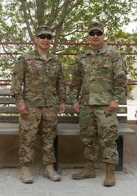 Cpt. Christopher De La Pena, Deputy Director AFCENT Lessons Learned Directorate, and Sgt. Nicholas De La Pena, Broadcast NCO AFCENT Public Affairs, pose together at Al Udeid Air Base, Qatar March 18. The brothers deployed together for the second time in 2016. (U.S. Army photo by Spc. Travis Terreo)