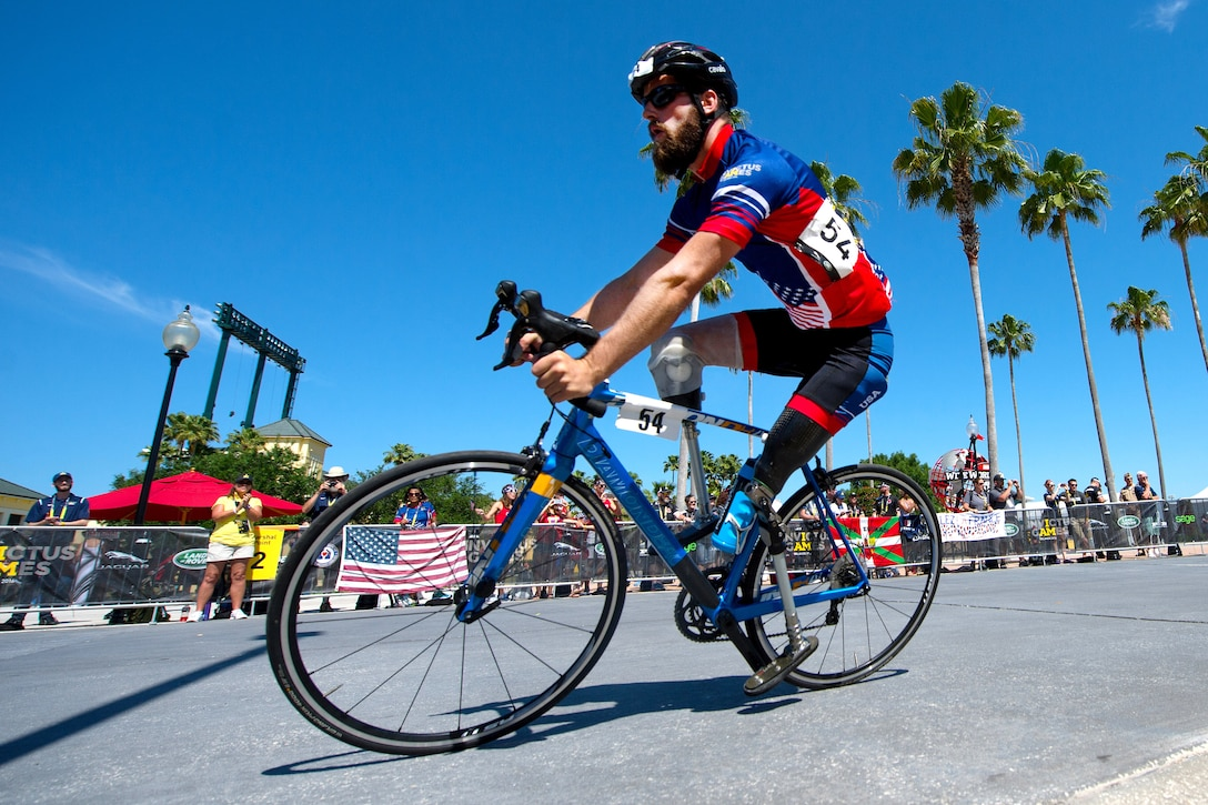 Army Veteran Stefan LeRoy competes in a bicycle event during the 2016 Invictus Games in Orlando, Fla., May 9, 2016. DoD photo by EJ Hersom