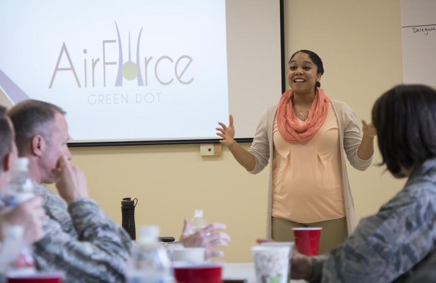 Staff Sgt. Sylvia Smith, Air Force Green Dot instructor, introduces the Green Dot program at the start of leadership training April 19, 2016, at Mountain Home Air Force Base, Idaho. Green Dot is a program designed to reduce interpersonal violence through cultural change. (U.S. Air Force photo by Tech. Sgt. Samuel Morse/Released)