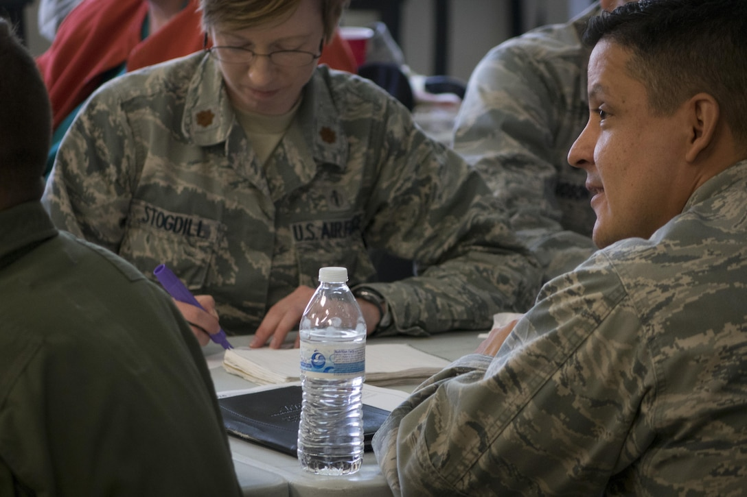 Students attending Green Dot leadership training write down personal barriers they might have towards intervening in a given scenario April 19, 2016, at Mountain Home Air Force Base, Idaho. Bystander intervention is a key concept of Green Dot. (U.S. Air Force photo by Tech. Sgt. Samuel Morse/Released)