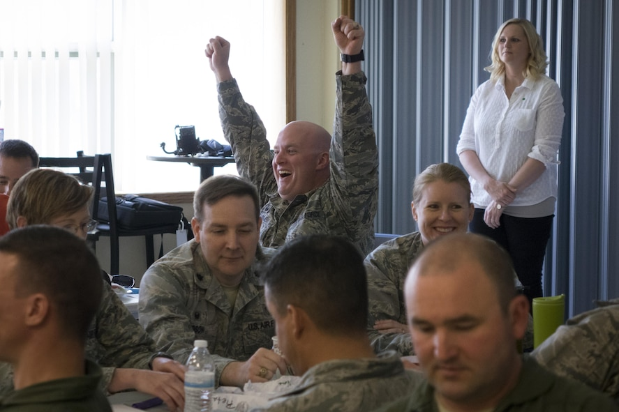 Maj. Jason Williams, 366th Security Forces Squadron commander, celebrates after hitting his intended target with a crumpled paper ball at Mountain Home Air Force Base, Idaho, April 19, 2016. Green Dot instructors aim to make the training fun through activities. (U.S. Air Force photo by Tech. Sgt. Samuel Morse/Released)