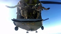 U.S. Air Force Special Tactics Airmen assigned to the 24th Special Operations Wing conduct a freefall jump from a U.S. Army CH-47 Chinook assigned to 5th Battalion, 159th Aviation Regiment, Fort Eustis, Va., during Emerald Warrior 16 over Eglin Range, Fla., May 7, 2016. Emerald Warrior is a U.S. Special Operation Command-sponsored mission rehearsal exercise during which joint special operations forces train to respond to real and emerging worldwide threats. (U.S. Air Force still frame from video by Tech. Sgt. Gregory Brook)
