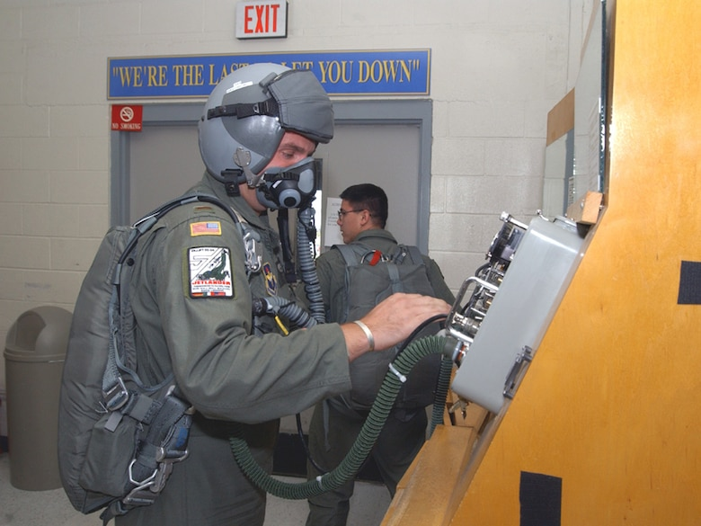A Euro-NATO Joint Jet Pilot Training student pilot runs a safety check on his oxygen equipment as part of his pre-flight process at Sheppard Air Force Base, Texas. This equipment, which provides oxygen to the pilot, helps prevent the effects of hypoxia and carbon monoxide poisoning while flying at high altitudes. (U.S. Air Force Photo/82nd Training Wing Public Affairs)