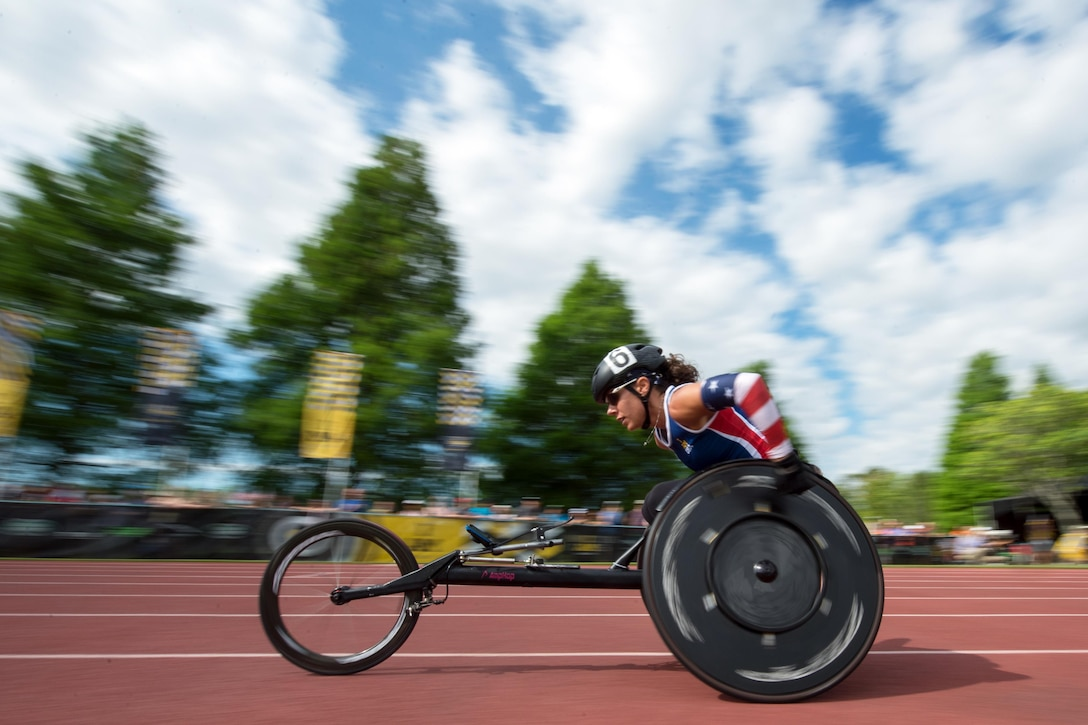 Army Capt. Kelly Elmlinger, a member of the U.S. team, races a wheelchair to victory during the 2016 Invictus Games in Orlando, Fla., May 10, 2016. Elmlinger won a gold medal in the event. DoD photo by EJ Hersom