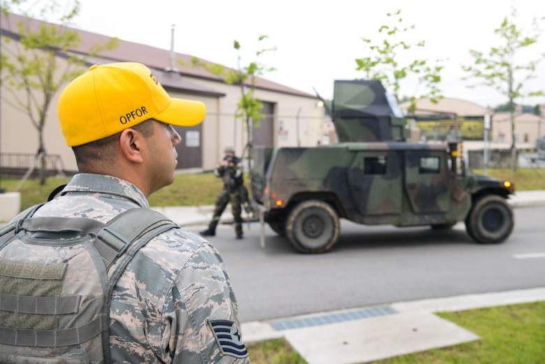 Tech Sgt. Jaime Gutierrez, 51st Fighter Wing inspection team member, performs quality control during an opposing forces scenario for Beverly Herd 16-01 May 10, 2016, at Osan Air Base, Republic of Korea. BH 16-01 is a week-long readiness exercise for the 51st FW which includes a plethora of scenarios like Chemical, Biological, Radioactive, and Nuclear response, active shooter and opposing forces.  (U.S. Air Force photo by Senior Airman Dillian Bamman/Released)