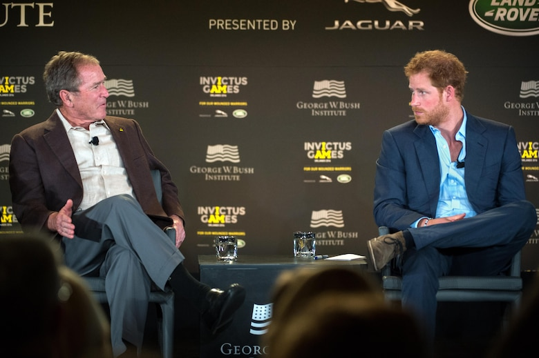 Former President George W. Bush and Britain's Prince Harry discuss the topic of post-traumatic stress during the 2016 Invictus Games Symposium on Invisible Wounds in Orlando, Fla., May 8, 2016. DoD photo by EJ Hersom