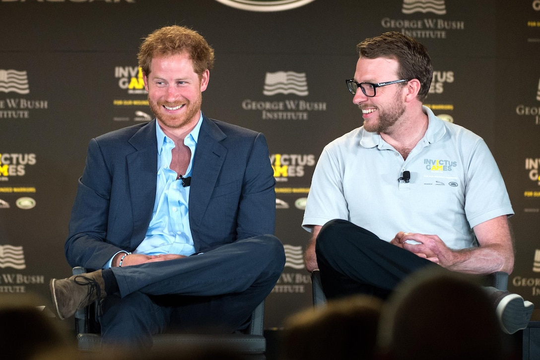 Britain's Prince Harry and former Royal Marine and Invictus competitor John-James Chalmers react during the 2016 Invictus Games Symposium on Invisible Wounds in Orlando, Fla., May 8, 2016. DoD photo by EJ Hersom