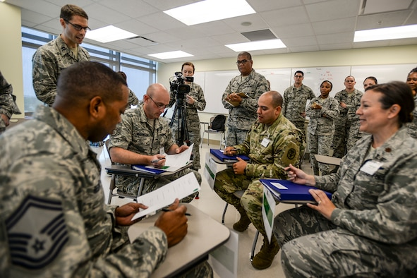 "Students simulate checking in and tracking patient movements in a mock clinic during the Gateway Academy's ""Seven Wastes"" class April 26, 2016, at the San Antonio Military Medical Center on Joint Base San Antonio-Fort Sam Houston, Texas. The goal of the Seven Wastes class was to find ways to eliminate wasted time during appointments which would help enhance patient care. (Courtesy photo)"