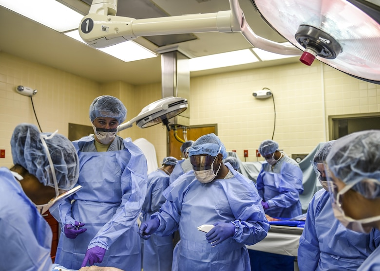 Medical technicians from the 59th Medical Wing and 433rd Reserve unit learn how to identify and treat multi-system injuries at the Sustainment for Trauma and Resuscitation Skills Program anatomy laboratory, April 21, 2016 at the Wilford Hall Ambulatory Surgical Center on Joint Base San Antonio-Lackland, Texas. (U.S. Air Force photo/Staff Sgt. Michael Ellis)