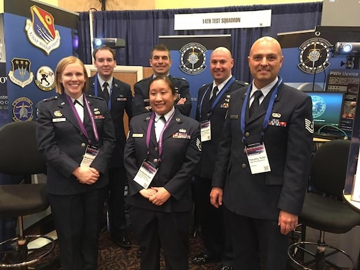 Members of the 14th Test Squadron manned a Cyber Exploitation booth demonstrating their unit's capabilities at the Armed Forces Communications and Electronics Association Cyberspace Symposium in Colorado Springs, Colorado. (Left to right) Capt. Meaghan Balser, Staff Sgt. John Marshall, Maj. Marc Weber, Staff Sgt. Kimberly Han, Maj. Matthew Shuter, Tech. Sgt. Timothy Teller.