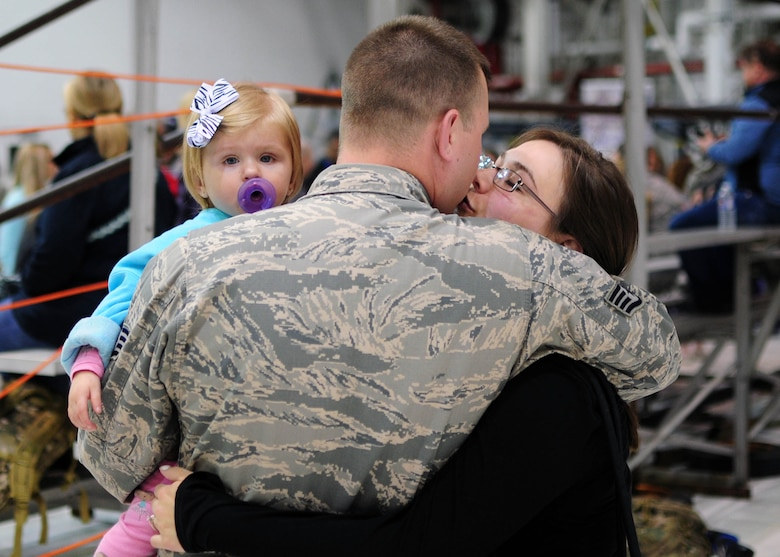 Family members share an embrace at Niagara Falls Air Reserve Station prior to deployment on May 7, 2016. The deployment will take these Airmen to Quatar in support of Operation Inherent Resolve. (U.S. Air Force photo by Staff Sgt. Richard D. Mekkri/released)