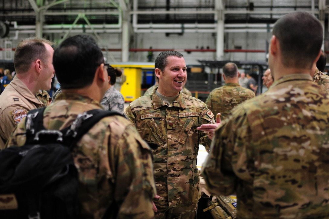 Members of the 914th Airlift Wing share a moment at Niagara Falls Air Reserve Station prior to deployment on May 7, 2016. The deployment will take these Airmen to Quatar in support of Operation Inherent Resolve. (U.S. Air Force photo by Staff Sgt. Richard D. Mekkri/released)