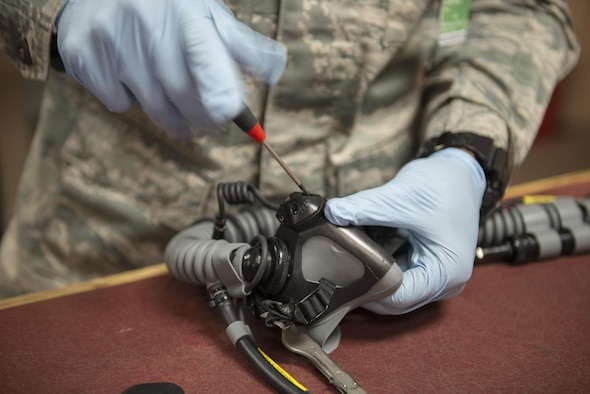 U.S. Air Force Staff Sgt. Jonathan McCullough, an 8th Operations Support Squadron aircrew flight equipment (AFE) journeyman assigned to Kunsan Air Base, Republic of Korea, performs maintenance on an oxygen mask, May 2, 2016, at Eielson Air Force Base, Alaska. AFE technicians must perform extensive work on each piece of equipment to ensure maximum safety for pilots. (U.S. Air Force photo by Staff Sgt. Ashley Nicole Taylor/Released)